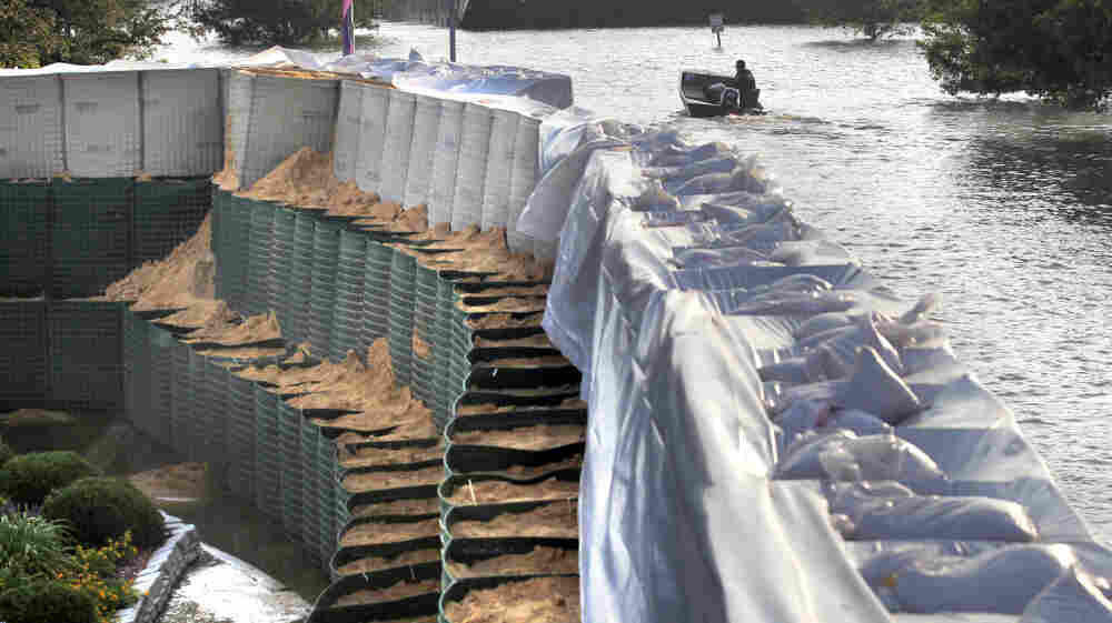 A wall of Hesco baskets protects the Riverside Medical Center in Vidalia, La., from Mississippi River floodwaters.
