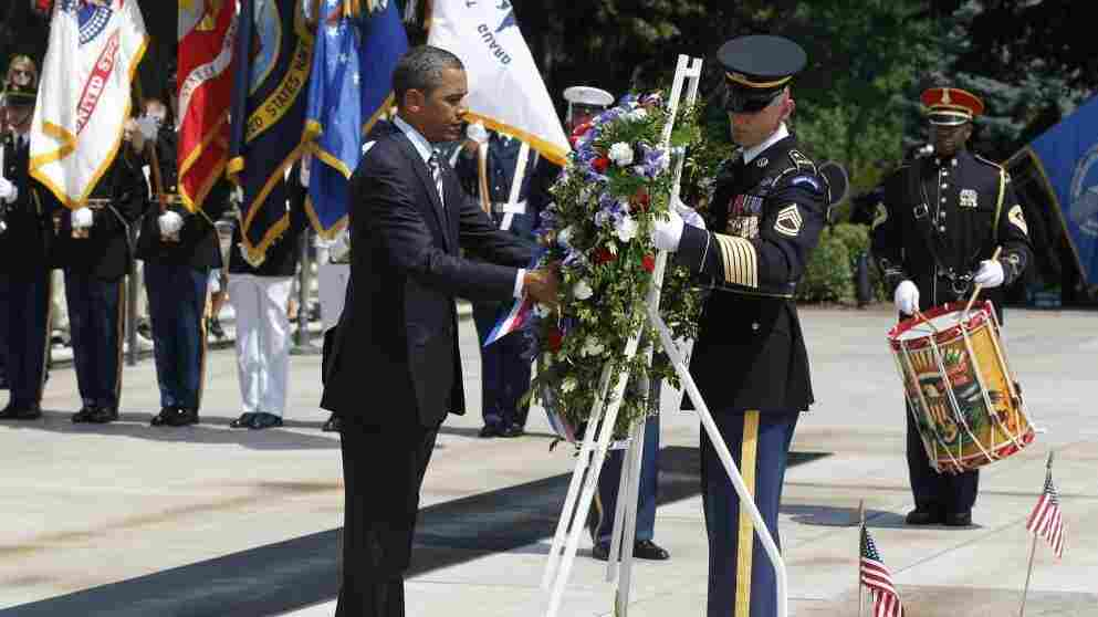 President Obama places a wreath at the Tomb of the Unknowns during a Memorial Day ceremony at Arlington National Cemetery.
