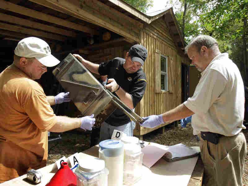 Franklin County, Mo., detectives sort through evidence during a raid of a suspected meth house in Gerald, Mo., on Sept. 2, 2010. Facing budget cuts, police forces from several states are training to handle meth lab cleanups rather than hiring trained cleanup crews. In 2010, Missouri had 1,950 meth lab busts and seizures.