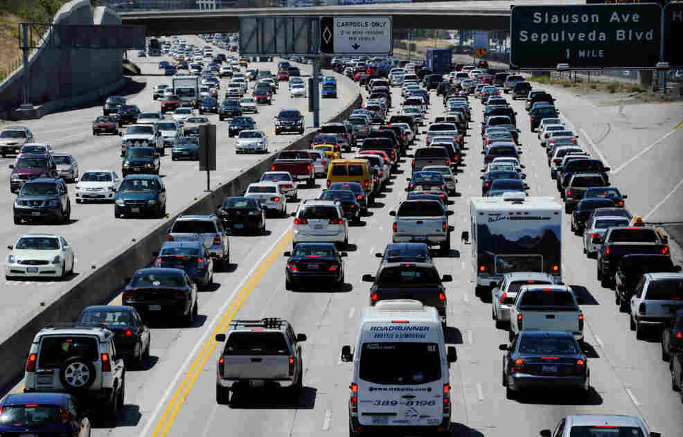 Traffic creeps northbound at the start of the Memorial Day holiday weekend Friday in Los Angeles.  More than 35 million people were expected to travel over the weekend.