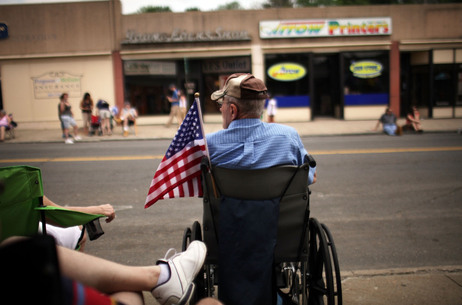 People wait for the start of the Memorial Day Parade in Ansonia, Conn.