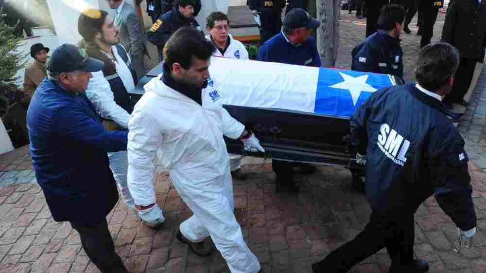 Forensic personnel transport the coffin with the remains of former Chilean President Salvador Allende at the General Cemetery in Santiago on May 23.