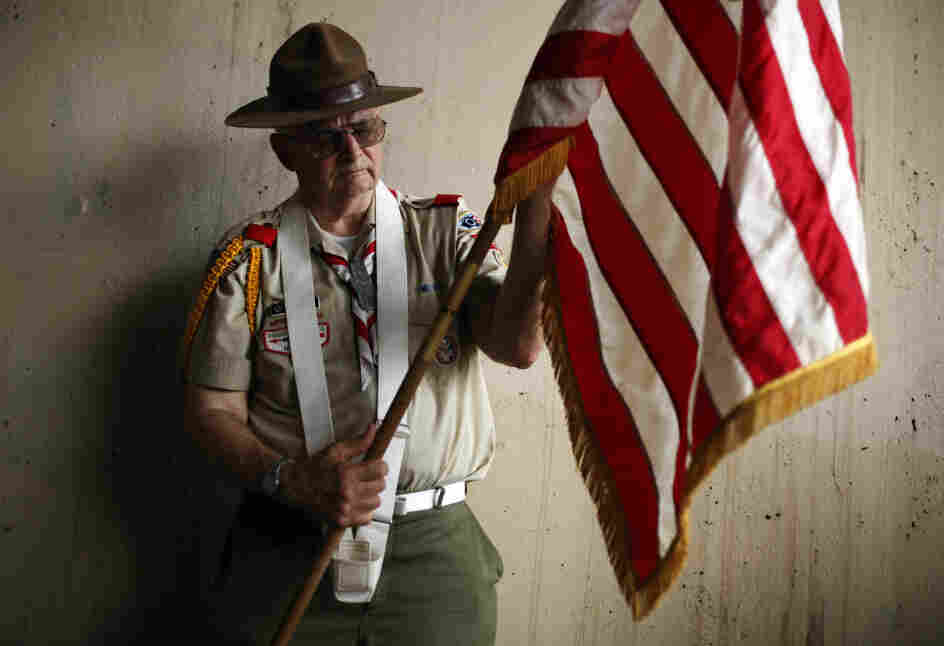 Richard Marsden with Boy Scout Troop 226 prepares an American flag before a Memorial Day parade in Philadelphia on Monday.