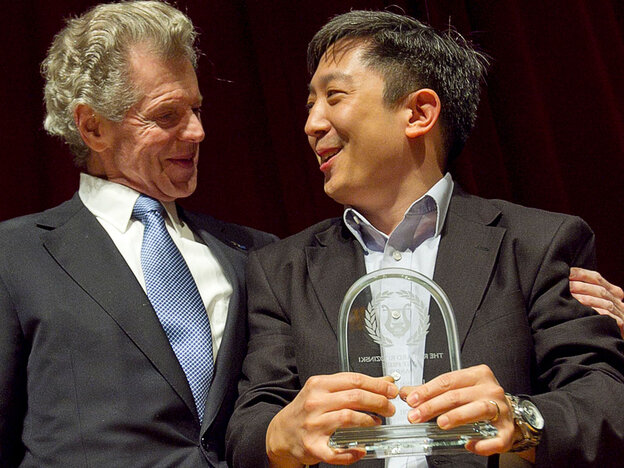 Van Cliburn presents Christopher Shih with the First Place prize for winning the Sixth  International Piano Competition for Outstanding Amateurs in Fort Worth, Texas.