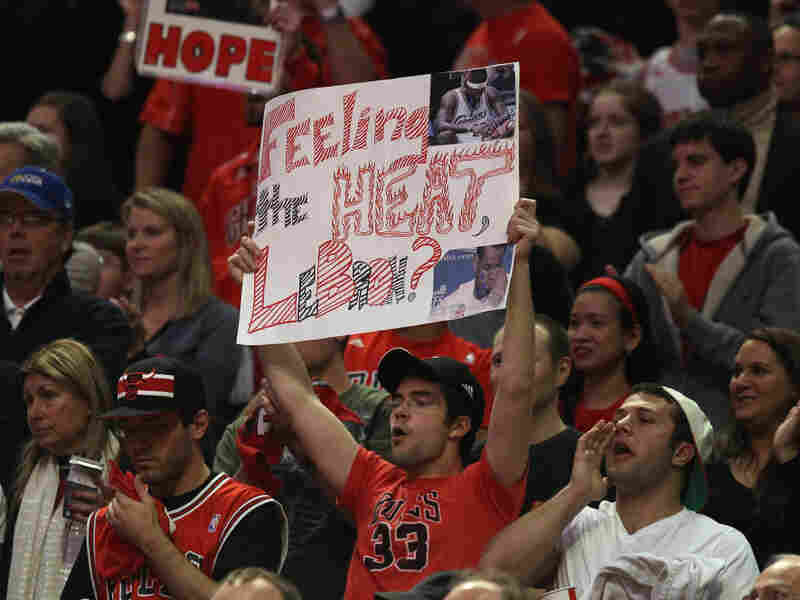 A fan of the Chicago Bulls  holds up a sign mocking LeBron James of the Miami Heat.