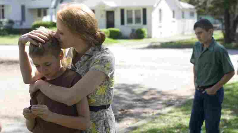 A Mother's Love: Jessica Chastain plays Mrs. O'Brien, mother of R.L.(Laramie Eppler, left), Jack (Hunter McCracken, right) and Steve (not pictured), and a character who filmmaker Terrence Malick portrays as the very embodiment of grace.