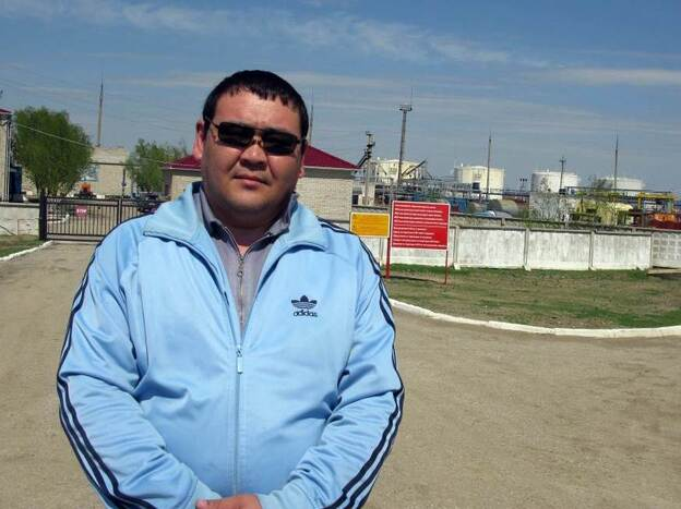 Nurlan Akhmetalin, 38, stands in front of a Chinese-owned oil processing facility near Aktobe, Kazakhstan. Now a cab driver, he worked for the China National Petroleum Corp. from 1996 to 2009. He made good money, but became less comfortable with how he says Chinese bosses treated employees and suspicious of China's intentions in his country.