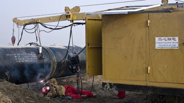 A worker welds at the China-Kazakhstan pipeline junction in Xinjiang, China, in 2008. (Getty Images)