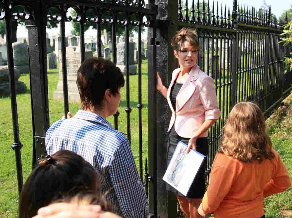 Former Alaska Gov. Sarah Palin, center, visits a Civil War-era cemetery, Tuesday, May 31, 2011, at Gettysburg National Military Park.