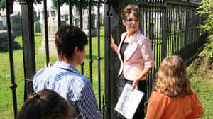 Former Alaska Gov. Sarah Palin, center, visits a Civil War-era cemetery, Tuesday, May 31, 2011, at Gettysburg National Military Park.