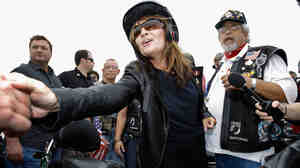 Former Alaska Gov. Sarah Palin greets some of the thousands of motorcycle enthusiasts and military veterans participating in the Rolling Thunder rally on Sunday.