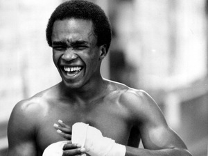 Welterweight boxer Sugar Ray Leonard, pictured above in August 1979, laughs as he tapes his hands before a workout in the boxing ring at the community center in Capitol Heights, Md.