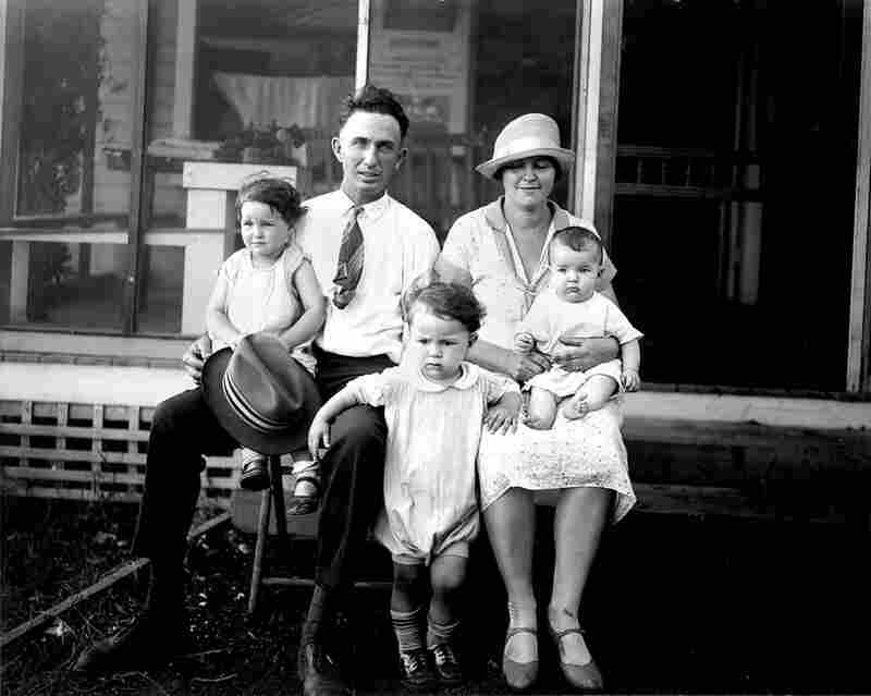 "The winners of the ""medium family class"" of a ""fitter families contest"" pose at the 1927 Kansas Free Fair. The American Eugenics Society was founded as a direct result of the Second International Conference on Eugenics, held in New York in 1921."