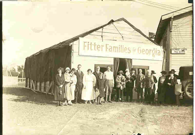 "People pose outside the ""Fitter Families"" headquarters at the Georgia State Fair in Savannah, 1924."