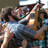 Dan Mangam leans into the crowd at the Yeti stage on Saturday afternoon.