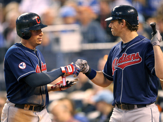 Asdrubal Cabrera (left) leads the resurgent Cleveland Indians in hitting. Here, he's congratulated by Travis Buck after crossing home plate.