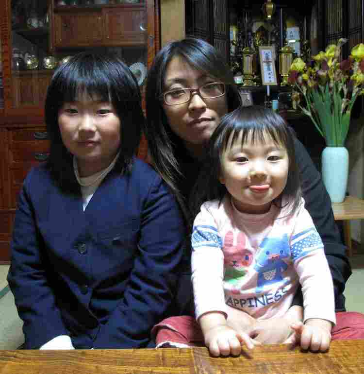 Kayo Watanabe, who works in life insurance, with her two daughters.  They'll soon leave this house, and their father and grandparents, to move farther away from the crisis-stricken nuclear plant.