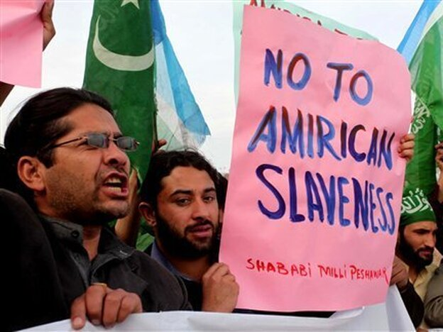 Anti-U.S. protesters in Peshawar, Pakistan, demonstrate in February against Ray Davis, the CIA contractor suspected in the shooting deaths of two Pakistani men.
