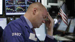 Specialists Evan Solomon works on the floor of the New York Stock Exchange on Wednesday, when major stock indexes fell steeply.