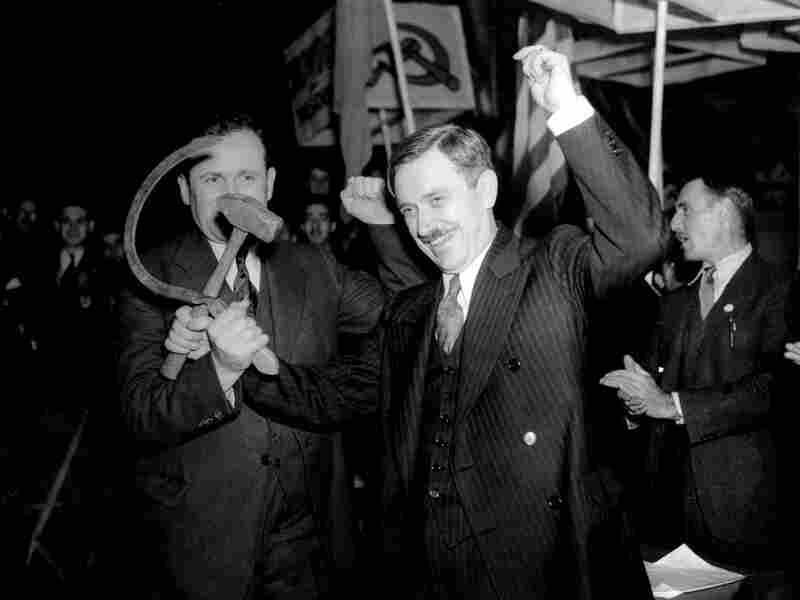 Earl Browder, right, the Communist Party's candidate in 1936 and 1940, crosses a hammer with a sickle.