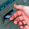 A man puts a card into an ATM in North Carolina last year. A recent study found that nearly a third of American consumers have reported credit card fraud in the past five years.