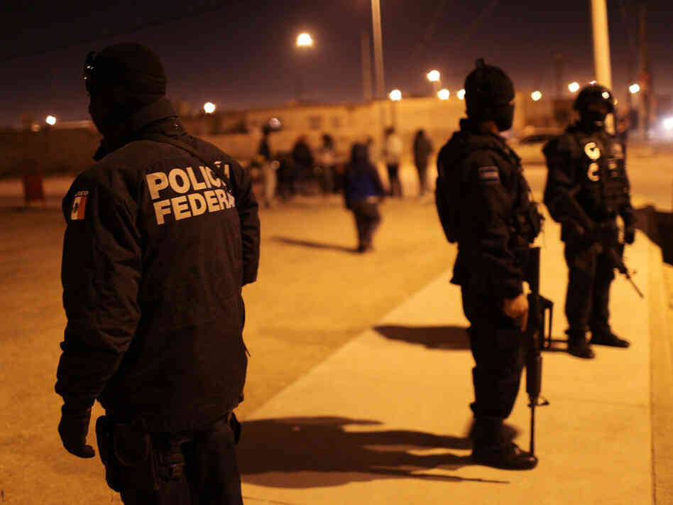 Mexican police at the scene of a drug-related shootout in Juarez on March 21,  2010.