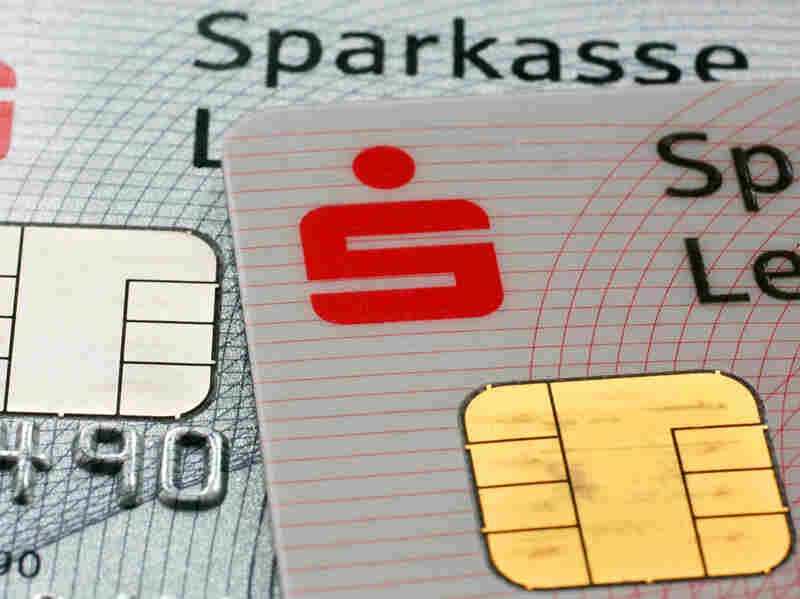 Security computer chips are seen on debit cards issued by the German bank Sparkasse, in 2010. When similar cards were introduced in France, card counterfeiting fell by 78 percent.