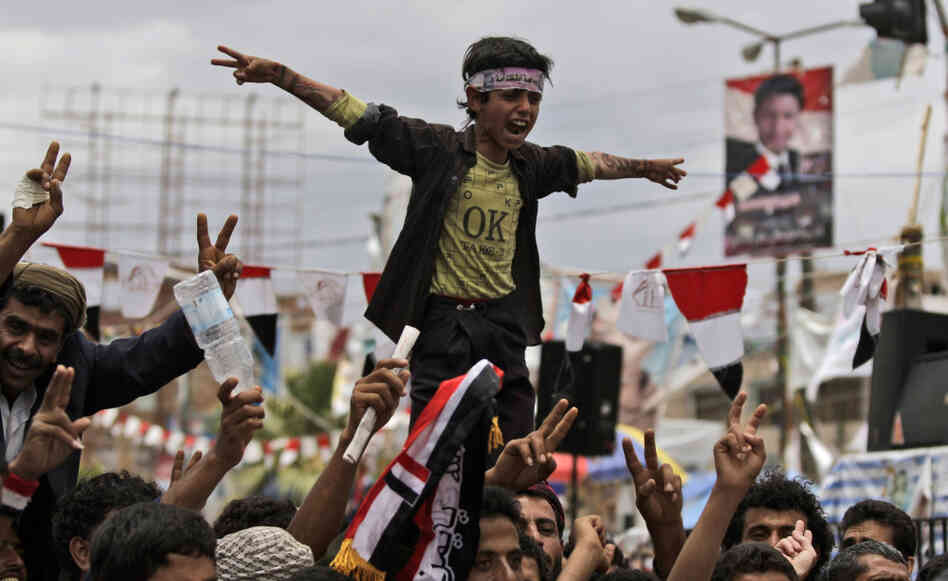 Anti-government protestors shout slogans during a demonstration demanding the resignation of Yemeni President Ali Abdullah Saleh, in Sanaa, Yemen on Thursday.
