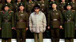 Everybody's happy. (Korean Central News Agency photo released on Jan. 18, 2009, showing North Korean leader Kim Jong Il posing with soldiers.)
