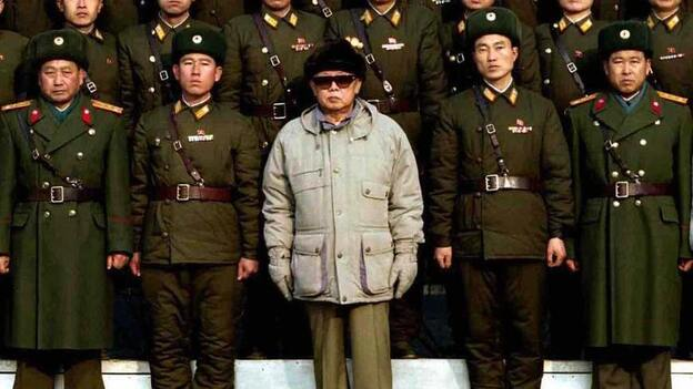Everybody's happy. (Korean Central News Agency photo released on Jan. 18, 2009, showing North Korean leader Kim Jong Il posing with soldiers.) (AFP/Getty Images)