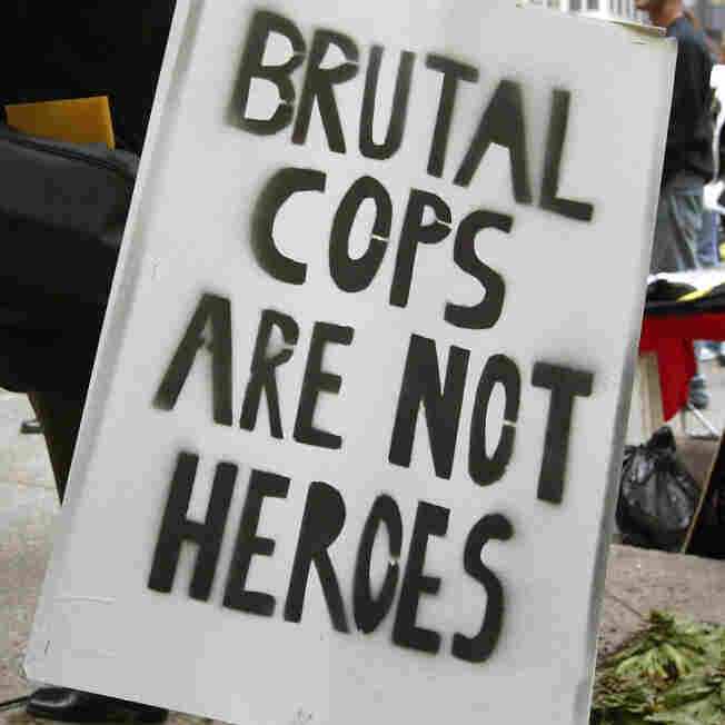 At a rally in Chicago in 2004, demonstrators display a sign that reads 'Brutal Cops Are Not Heroes.""