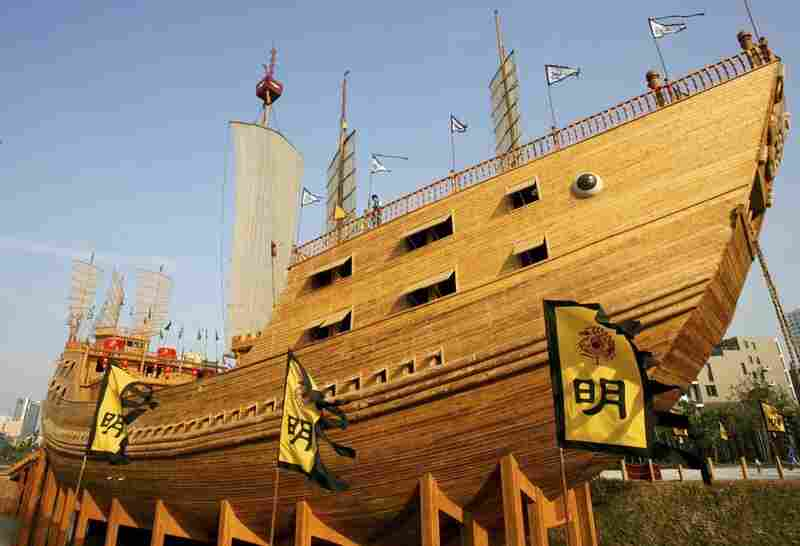 Tourists look out from a replica of the treasure ship. The ships sailed in enormous fleets.