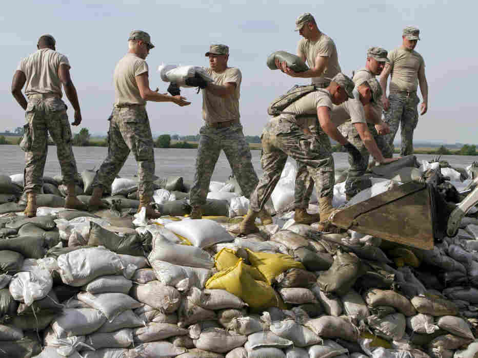 Army National Guardsmen help sandbag along the Missouri River in Dakota Dunes, S.D., on Thursday.
