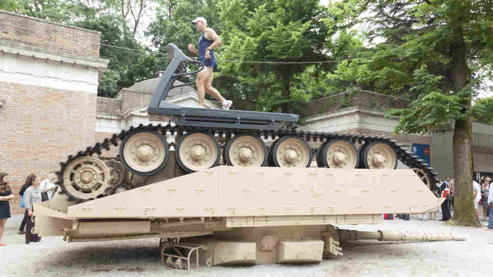Former Olympian Gary Morgan runs on a treadmill atop an overturned tank in Track and Field, by Jennifer Allora and Guillermo Calzadilla. The piece is part of the American Pavilion at the Venice Biennale.