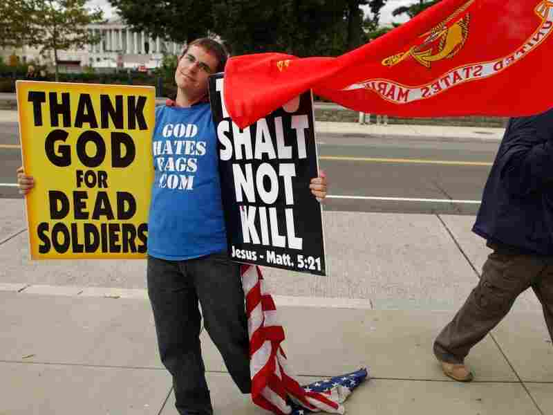 Westboro Baptist Church member Jacob Phelps stands outside the Supreme Court while justices heard oral arguments in Snyder v. Phelps, which tests the limits of the First Amendment. The Westboro Baptist Church was sued after demonstrating outside the funeral of a soldier killed in Iraq.
