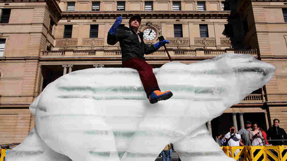 "The ""Sydney Ice Bear"" on Friday in Sydney, Australia. The bear was carved by British artist Mark Coreth from a 10-ton block of ice. The public will be welcomed to touch the bear, leaving imprints that will begin the melting process and act as a metaphor for how humans affect the environment."
