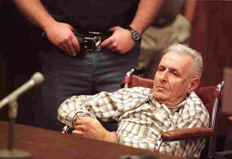 Dr. Jack Kevorkian sits handcuffed in a wheelchair during his arraignment on May 8, 1998, in Royal Oak, Mich. Kevorkian was charged with resisting arrest and assaulting a police officer while attempting to drop off a body at William Beaumont Hospital.