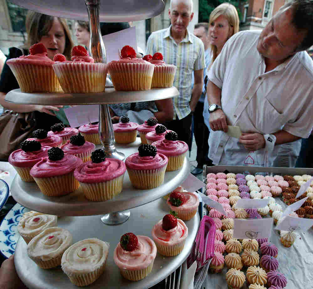 Customers look at the cupcakes in London, England.