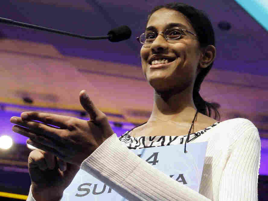 "Sukanya Roy, 14, smiles as she finishes spelling ""cymotrichous,"" correctly to win the National Spelling Bee, in Oxon Hill, Md. on Thursday, June 2, 2011."