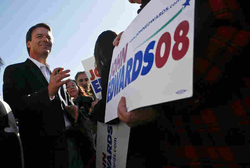 Democratic presidential candidate John Edwards signs autographs after speaking to supporters outside his Las Vegas campaign headquarters on Jan. 18, 2008.