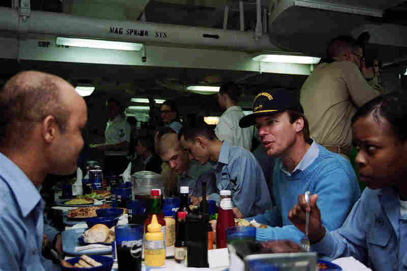 Then-Sen. Edwards dined with sailors from North Carolina aboard the aircraft carrier USS Theodore Roosevelt in the Arabian Sea, Jan. 9, 2002.