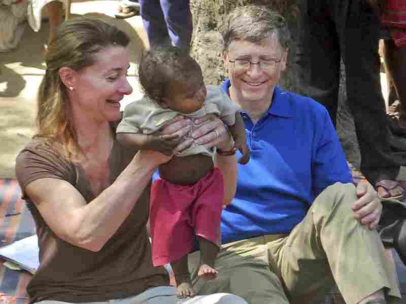 Microsoft Corp. founder and philanthropist Bill  Gates and his wife Melinda Gates attend  to a child as they meet with members of the Mushar community at Jamsot Village  near Patna, India, on March 23.