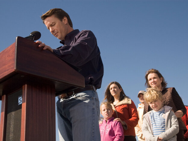 John Edwards exits the 2008 presidential race as his family watches, Jan. 30, 2008.