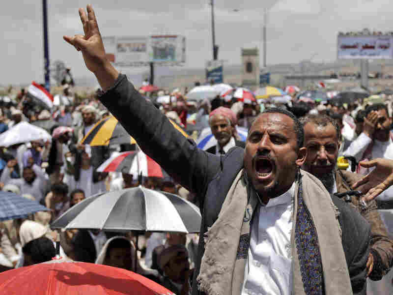 An anti-government protester holds up his hand during a demonstration demanding the resignation of Yemen's president. A government official said President Ali Abdullah Saleh was lightly injured when opposition tribesmen struck his palace with rockets on Friday.