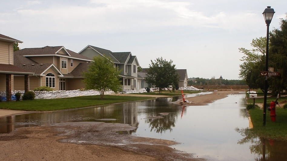 Water pools in the street in front of sandbagged homes in Pierre, S.D., Thursday. South Dakota's governor has urged some residents to evacuate from three cities considered early trouble spots as officials brace for a prolonged period of Missouri River flooding