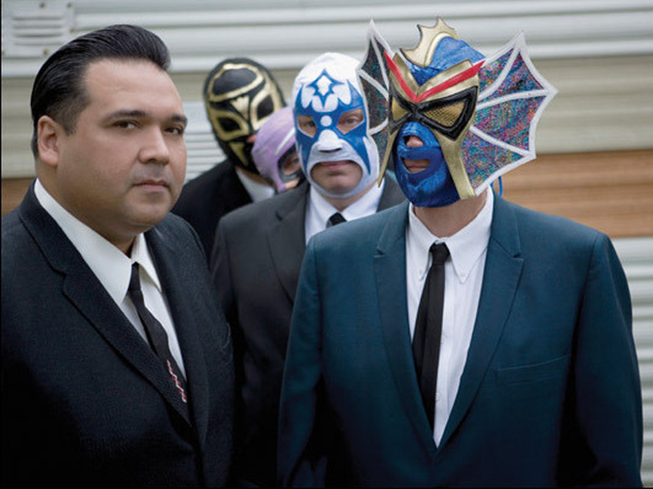 Western swing/rockabilly titan Big Sandy (left) stopped into the <em>Fresh Air</em> studios with tourmates Los Straitjackets in 2007. A series of benefit concerts will be held this summer  to raise money to help cover medical expenses for bandmate Danny Amis.