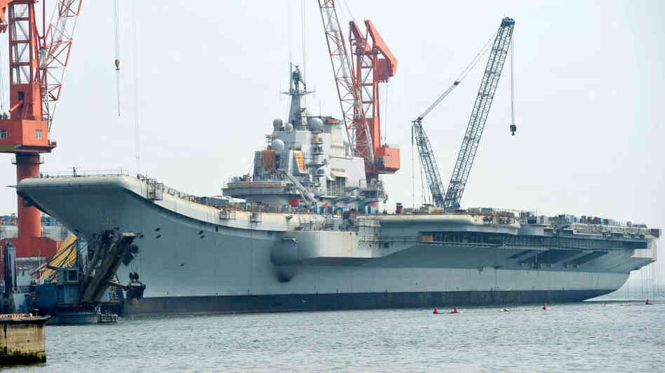 "The Varyag aircraft carrier, shown April 26, is being renovated at a shipyard in the northern Chinese city of Dalian. After years of refurbishing work, the carrier — bought from Ukraine — has been described as ""on the verge of setting out"" by Xinhua state news agency."