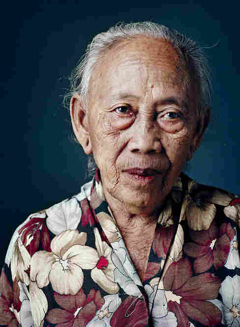 """Semi, born 1931, Tawangmangu, Central Java As a 13-year-old girl, Semi was picked up from home almost daily and forced into prostitution at different locations, often nearby hotels. """"They took us, and then we had to wash up, put on a kimono and do our makeup with lipstick and powder,"""" she says. """"After that, I had to massage the soldiers and cuddle with them, let them kiss me, and such."""""""