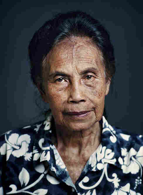 """Umi, born 1930, Sukabumi, West JavaUmi was 13 when two of her sisters were taken to a brothel by Japanese soldiers; she was taken there after a few months. Umi married at a later age to a family member with whom she had four children. """"My children don't have a clue,"""" she says. """"Because my sisters didn't want it, I've never told them anything."""""""