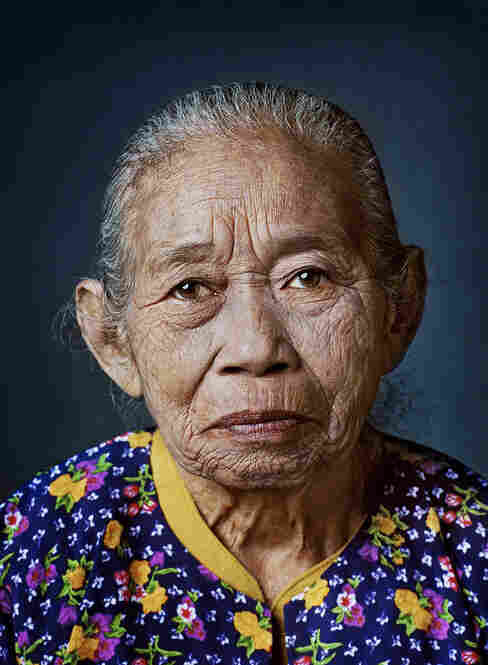 Ronasih, born 1931, Serang, West JavaAs a 13-year-old girl, Ronashi was picked up on her way home from school by a soldier and locked up in nearby barracks where he raped her routinely for months. Immediately after the war she underwent surgery for her internal injuries. ... She's been married five times, divorced several times after just a few months and has never been able to bear chil...